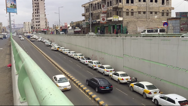 Figure 4: Long line of taxis waiting for gas to be available at a gas station in the city of Sana'a. (Photo credit: Naser Noor)