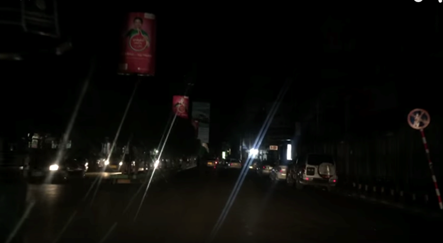 Figure 5: A busy street in Sana'a in total darkness because of electricity shutdown, except for the lights of the cars. (Photo credit: Naser Noor)