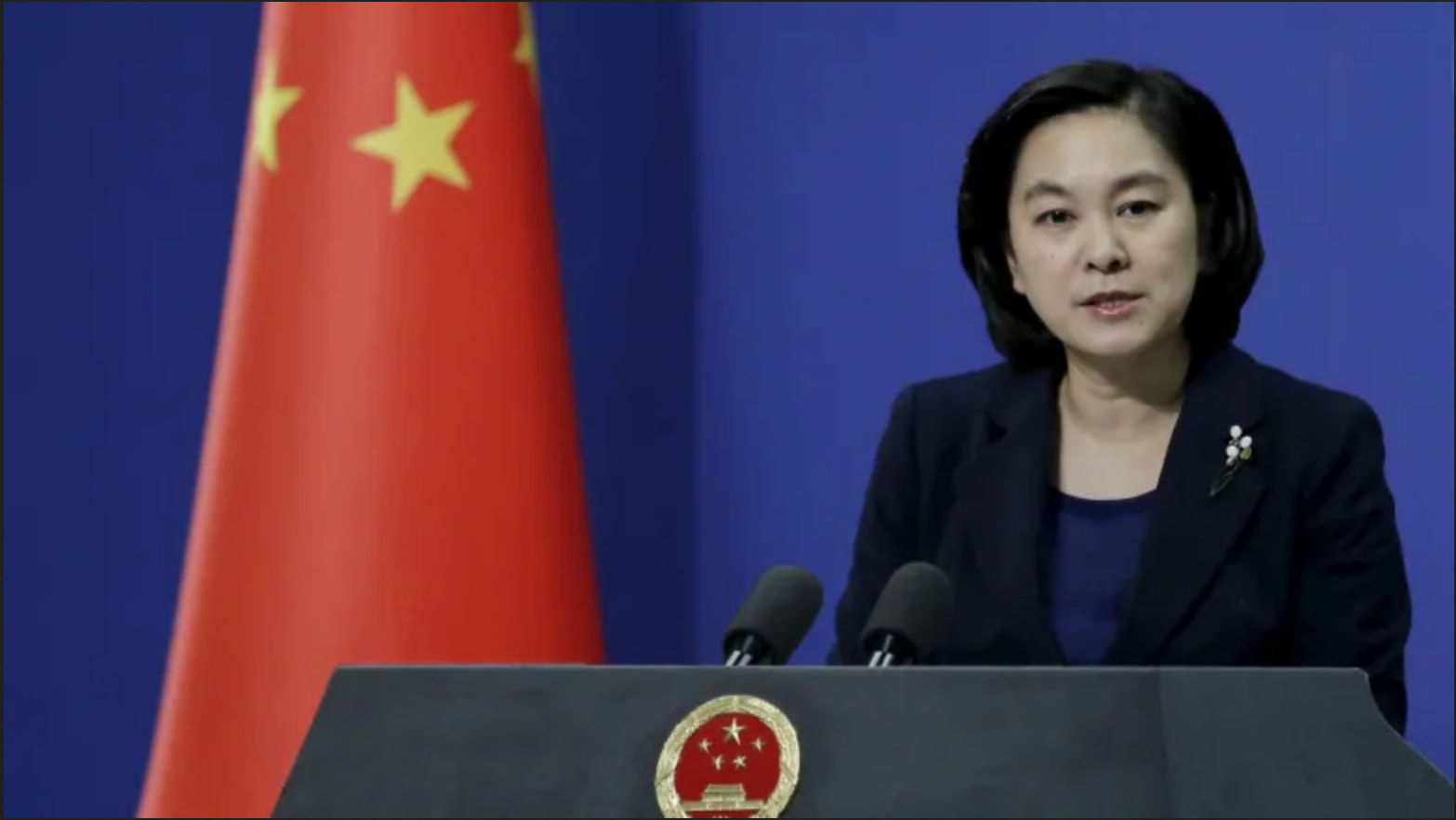 Chinese Foreign Ministry Spokesperson Hua Chunying conducting a daily briefing
